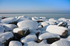 Rocks of Dutch breakwater in wintertime Stock Photos