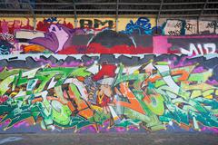 Graffity art at a gangway under a viaduct - stock photo