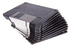 Pile of 3.5 inch computer diskettes - stock photo