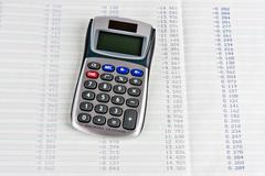 Calculator with a hard copy of tabular digits Stock Photos