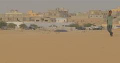 People walking in the Desert near Nouakchott, Mauritania (4K) Stock Footage
