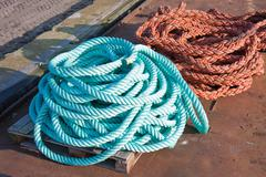 Two nylon ropes at a ship in the harbor Stock Photos
