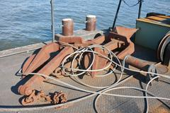 Floating workshop with steel cables and anchors - stock photo