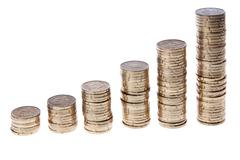 Increasing piles of european 20 cent coins, isolated on a white background - stock photo