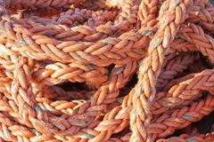 Nylon rope at a ship in the harbor - stock photo