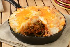 Shepherds pie in a cast iron skillet - stock photo