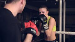 Woman Exercising With Trainer At Boxing In Basement - stock footage