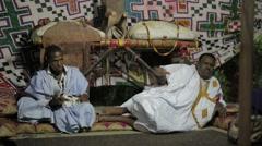 Mauritanian Man Playing Tidinit beside a Singing Musician Stock Footage