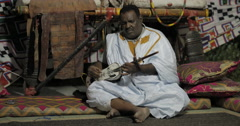 Mauritanian Musician Playing Instrument (4K) Stock Footage