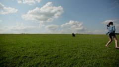 girl running barefoot on the grass Stock Footage