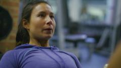 Close up of woman using a leg press machine Stock Footage