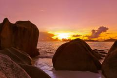 Sunset on beach Source D'Argent at Seychelles - stock photo