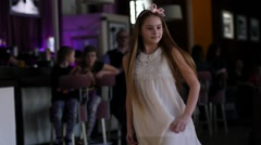 Little fashion girl on a catwalk Stock Footage