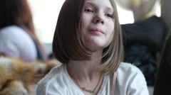Pretty school age girl portrait Stock Footage