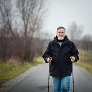 Senior man nordic walking, enjoying the outdoors, the fresh air, - stock photo