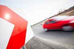 Stock Photo of Traffic concept: car driving fast through a sharp turn (motion b