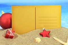 Christmas greeting card on the beach Stock Photos
