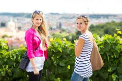 Stock Photo of Two pretty, young women sightseeing in Prague historic center