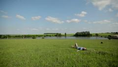 Beautiful Girl Lying on the Meadow  Stock Footage