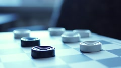 Checkers on checkerboard Stock Footage