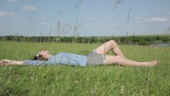 Girl havig a rest near the river Stock Footage