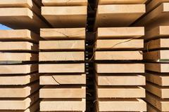 Stack of new wooden studs at the lumber yard Stock Photos