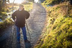 Senior man nordic walking, enjoying the outdoors, the fresh air, Stock Photos