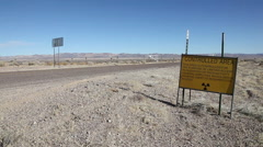 CAR DRIVES TO ATOMIC TEST SITE Stock Footage