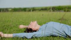 Happy girl lying on the grass Stock Footage