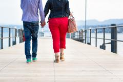 Opposites Attract - Quite disproportionate young couple walking - stock photo