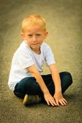 Stock Photo of Little thoughtful boy child portrait outdoor