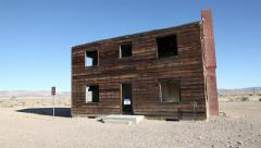 ATOMIC TESTING HOUSE WOOD HOUSE IN NEVADA DESERT Stock Footage