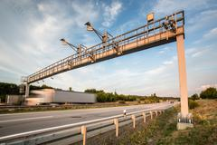 Truck passing through a toll gate on a highway (motion blurred i - stock photo