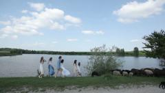 Girls go near the lake (FLAT COLOR) Stock Footage