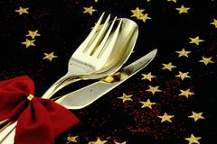 Christmas cutlery. Spoon, fork and knife stacked up on a starry background Stock Photos