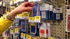 Woman choosing needles inside Walmart store. Stock Footage