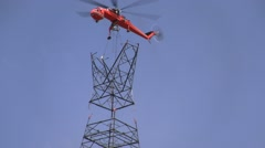 500kV Tower Construction Contruction Air Crane lowering piece - stock footage