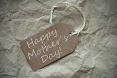 Beige Label With Happy Mothers Day Paper Background Stock Photos