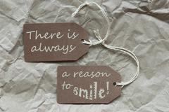 Two Brown Labels With Quote Always Reason Smile Paper Background Stock Photos