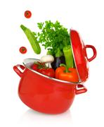 Colorful vegetables coming of a red cooking pot - stock photo