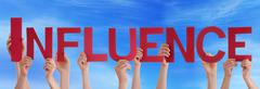 Many People Hands Holding Red Straight Word Influence Blue Sky - stock photo