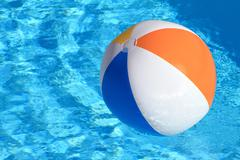 Summer background. Beach Ball on the swimming Pool Stock Photos