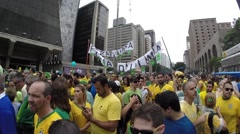 Protesters marching on Paulista Avenue against the corruption - stock footage