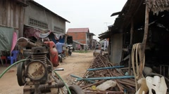 Junk machines trash and life on Asian slum market street Stock Footage