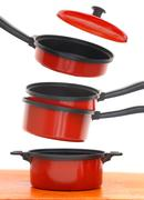 Red cookware set on white background Stock Photos