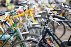 Bike rental service/Many bikes in a city context Stock Photos