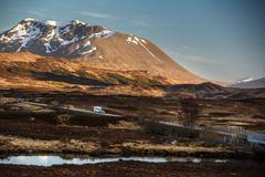 Open road leading through Glencoe, Scottish Higland, Scotland, U - stock photo