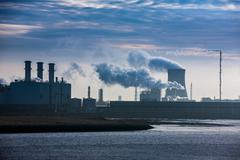 Power plant releasing green house fumes/gases - stock photo
