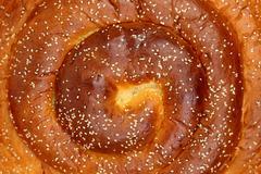 Sweet spiral brioche bread with sesame seeds center closeup - stock photo