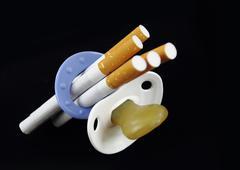 Maternity and cigarette - stock photo